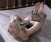 Naked blonde gets roped, hogtied, hanged and fucked