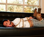 Vixen hogtied and ball-gagged on the couch